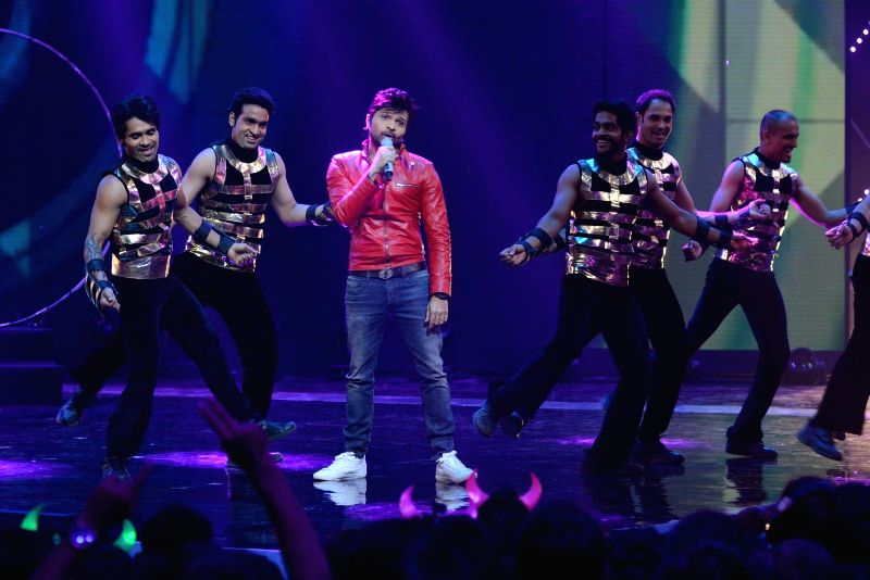 Actor cum singer Himesh Reshammiya perform during the sets of India's Raw Star grand finale in Mumbai on 30th November, 2014