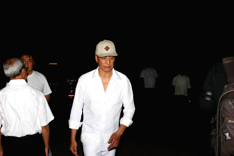 Actor Danny Denzongpa during the funeral of his manager Madan Mohan, in Mumbai, on Feb 10, 2015.