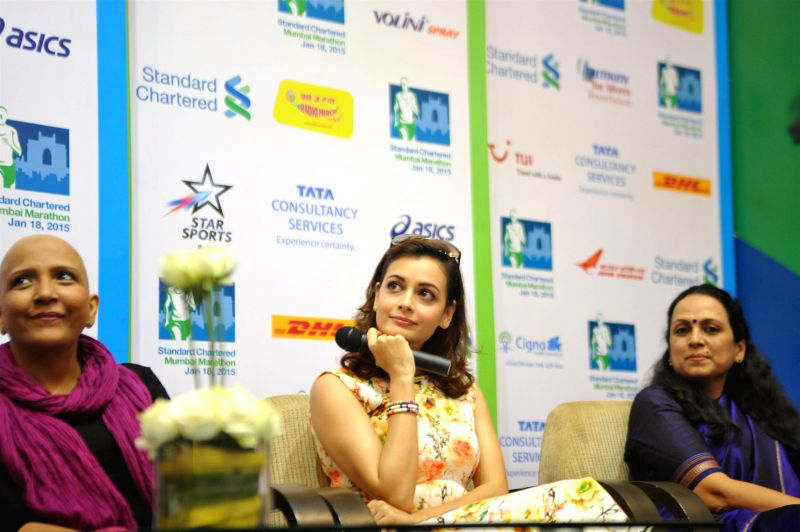 Actor Dia Mirza, Swades foundation with Mithila Balse, Cancer Patient, Indian Cancer Society, Change Investor during the press conference to raise funds for Swades foundation organised by ... - Dia Mirza