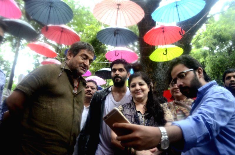 Actor-director-producer Mahesh Manjrekar with Sharmila Thackeray and Amit Thackeray takes a selfie in Mumbai on June 18, 2015.