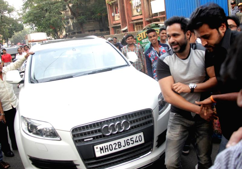 Actor Emraan Hashmi snapped with his Audi Q7 car during the promotion of film Ungli in Mumbai on on Nov 28, 2014. - Emraan Hashmi