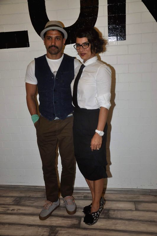 Actor Farhan Akhtar along with his wife and hairstylist Adhuna Akhtar during the launch of her 18th store of BBlunt at R City Mall, Ghatkopar in Mumbai, on Nov. 22, 2014.