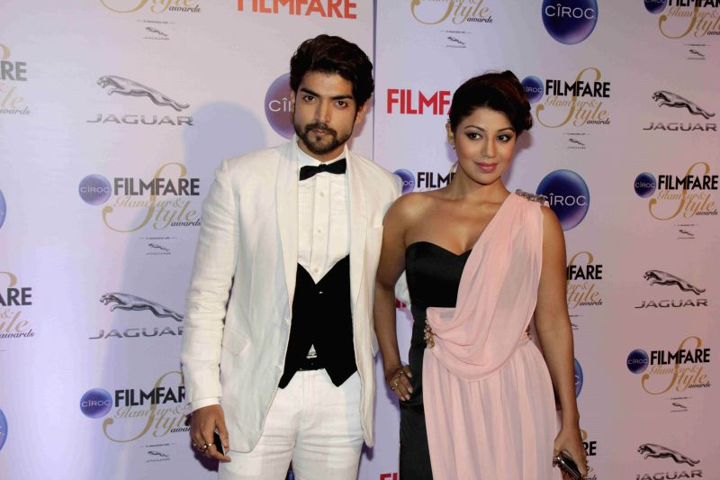 Actor Gurmeet Choudhary along with his wife Debina Bonnerjee during the Filmfare Glamour and Style Awards in Mumbai on Feb 26, 2015. - Gurmeet Choudhary and Debina Bonnerjee
