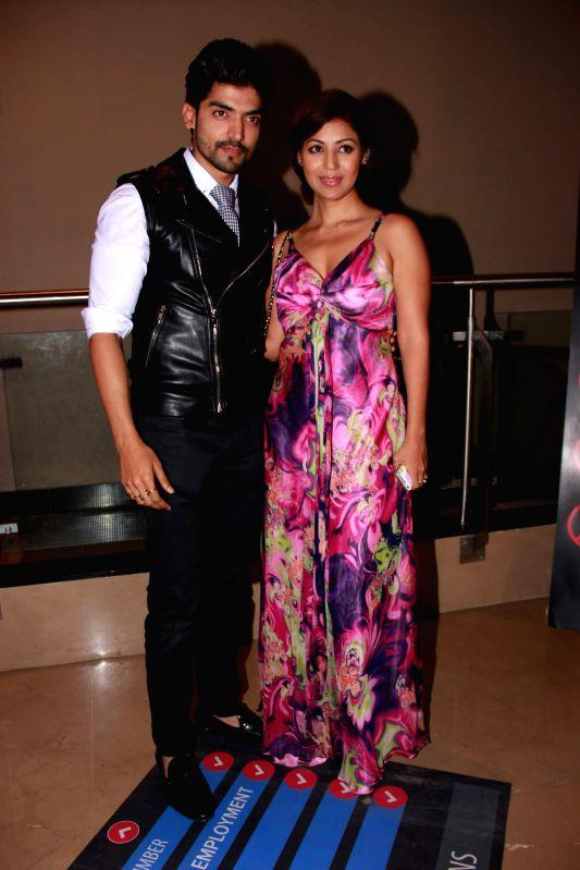 Actor Gurmeet Choudhary with his wife and actor Debina Bonnerjee during screening of the film Khamoshiyan in Mumbai on January 29, 2015. - Gurmeet Choudhary and Debina Bonnerjee