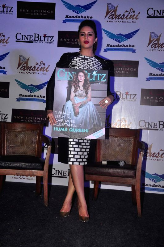 Actor Huma Qureshi during the cover launch of Cine Blitz magazine's January issue, in Mumbai, on Jan. 12, 2015.