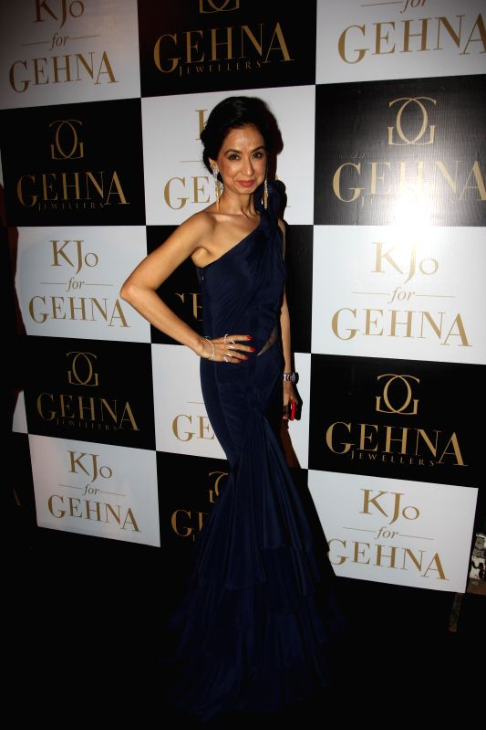 Actor Ileana D`Cruz and Nimrat Kaur during Gehna Jewellers select collection showcase of jewellery line by Karan Johar in Mumbai, on Dec. 16, 2014. - Ileana D and Nimrat Kaur