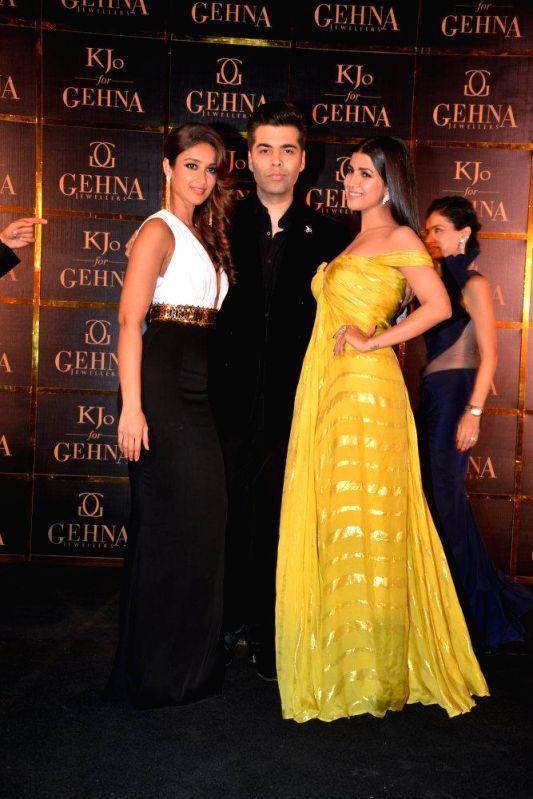 Actor Ileana D`cruz, Karan Johar and Nimrat Kaur during Gehna Jewellers select collection showcase of jewellery line by Karan Johar in Mumbai, on Dec. 16, 2014. - Ileana D and Nimrat Kaur