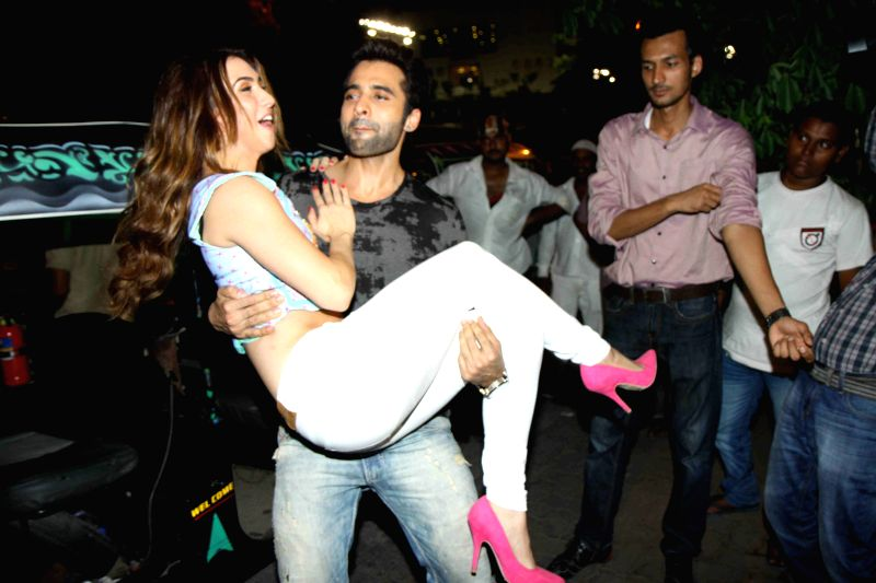 Actor Jackky Bhagnani and Amierican actress Lauren Gottlieb during a promotion for their latest movie `Welcome to Karachi, in Mumbai, India on April 23, 2015. - Jackky Bhagnani