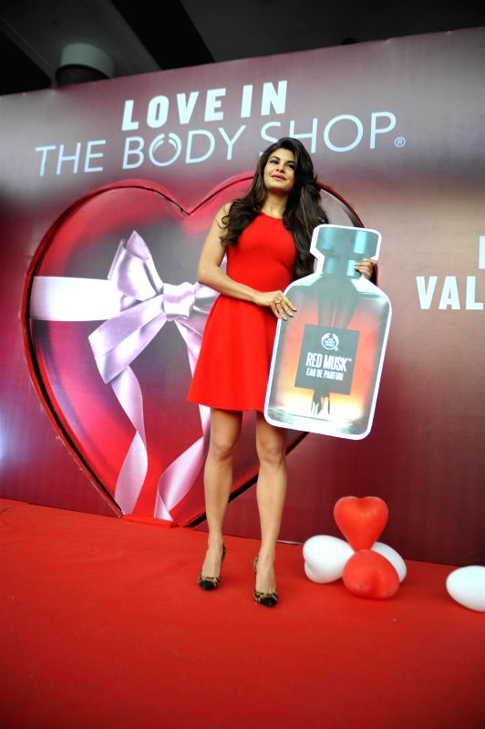Actor Jacqueline Fernandes unveils the Red Musk Eau De Parfum during the opening of The Body Shop store in Mumbai on Jan. 31, 2015.