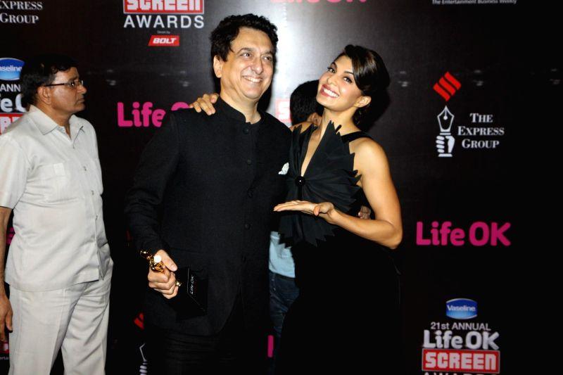 Actor Jacqueline Fernandez and filmmaker Sajid Nadiadwala during the 21st Annual Life OK Screen Awards in Mumbai on Jan. 14, 2015. - Jacqueline Fernandez