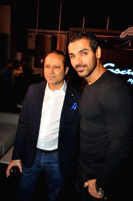 Actor John Abraham along with Vineet Jain, MD, Times Group during the launch of Yamaha Fascino 2015 calendar in Mumbai on 13th Jan 2015 - John Abraham and Vineet Jain