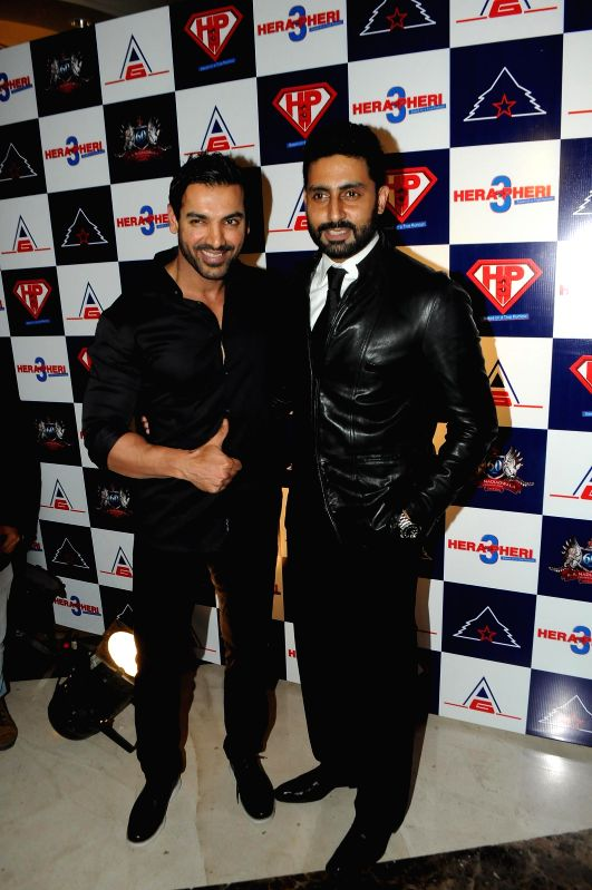 Actor John Abraham and Abhishek Bachchan during unveiling of the starcast of film Hera Pheri 3, in Mumbai, on Jan. 12, 2015. - John Abraham and Abhishek Bachchan