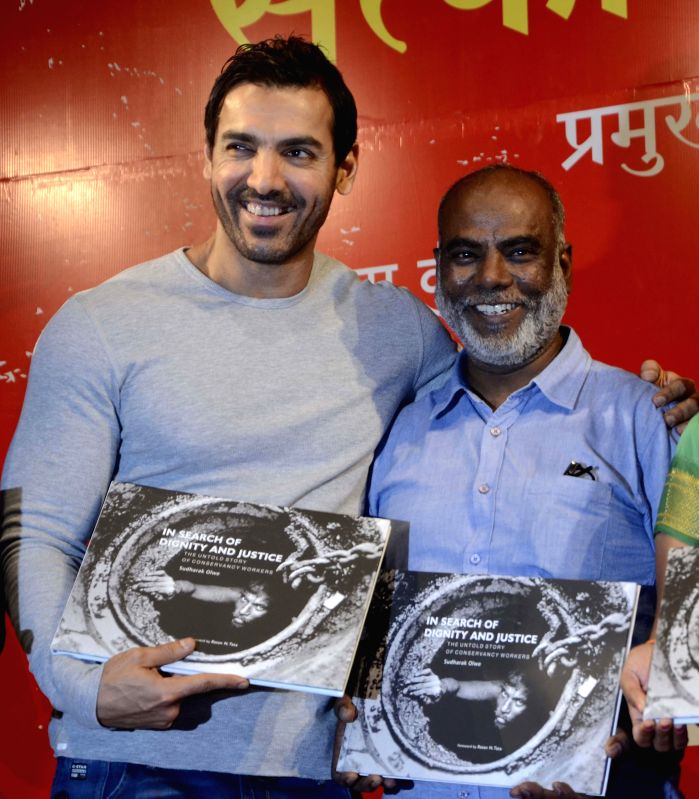 Actor John Abraham at the launch of photojournalist Sudharak Olwe's book `In Search Of Dignity And  Justice` in Mumbai, on Jan 22, 2015. - John Abraham