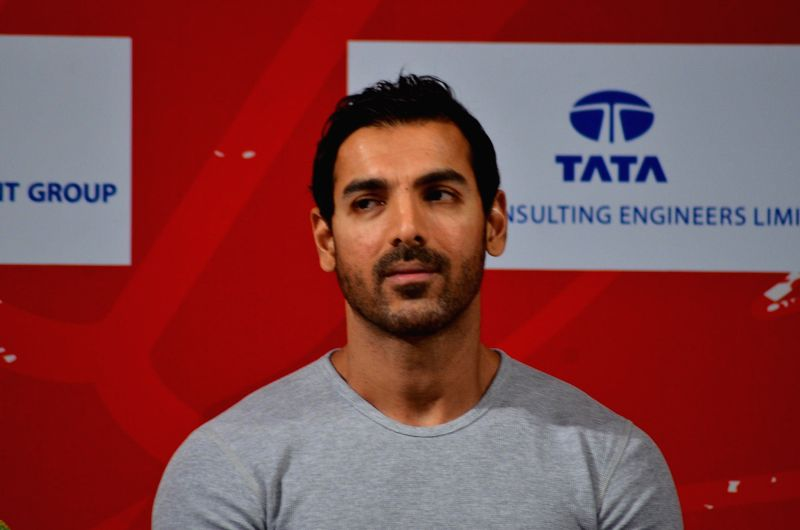 Actor John Abraham during the release of Photojournalist Sudharak Olwe book In search of Dignity and Justice, in Mumbai, on Jan. 22, 2015. - John Abraham