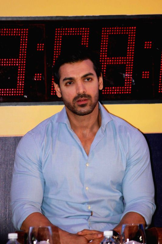 Actor John Abraham during the unveiling of the Official Lead Car for the Standard Chartered Mumbai Marathon 2015 in Mumbai on 7th Jan 2015 - John Abraham