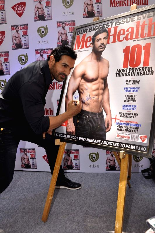 Actor John Abraham during the unveiling of Men`s Health magazine`s latest cover in Mumbai on March 11, 2015.
