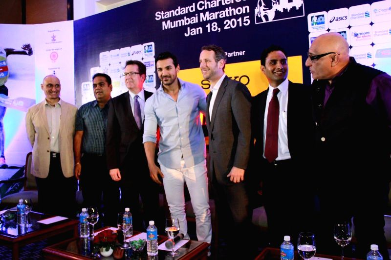 Actor John Abraham with Daniel Mobley, Regional Head, Corporate Affairs - India and South Asia, Standard Chartered during the unveiling of the Official Lead Car for the Standard Chartered ... - John Abraham