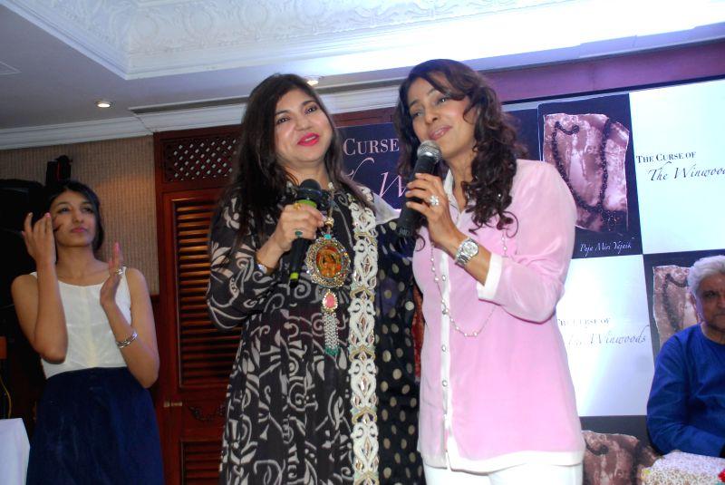 Actor Juhi Chawla and ,Alka Yagnik at the launch of Puja Miri Yajnik's book `The Curse of The Winwoods` in Mumbai, on Jan 5, 2015. - Juhi Chawla