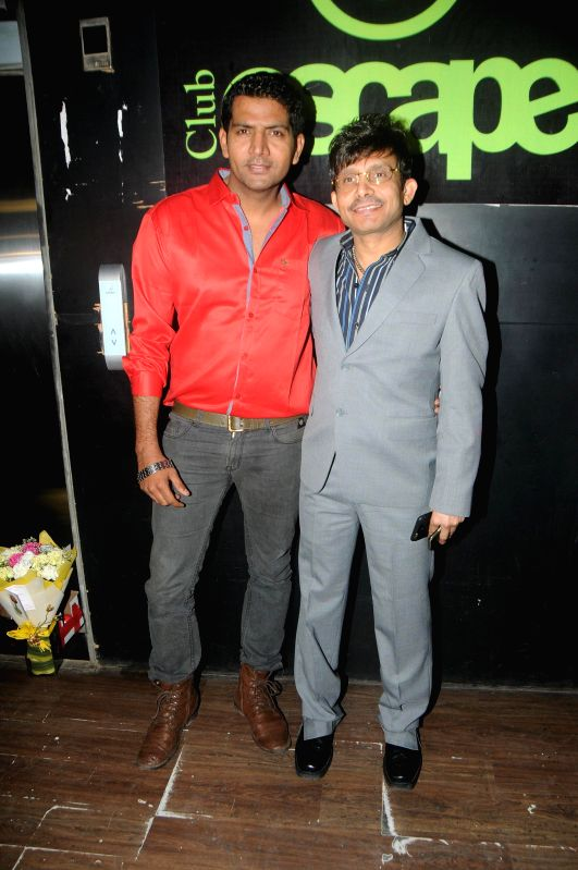 Actor Kamaal R Khan with Ashutosh during Kamal Khan's birthday party in Mumbai during Kamal Khan's birthday party in Mumbai, on jan. 08, 2015. - Kamaal R Khan