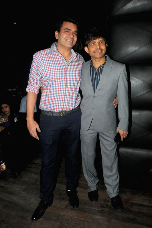 Actor Kamaal R Khan with Ramji Gulati during Kamal Khan's birthday party in Mumbai during Kamal Khan's birthday party in Mumbai, on jan. 08, 2015. - Kamaal R Khan
