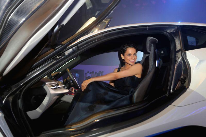Actor Kangana Ranaut during the launch of BMW i8 hybrid sports car in Mumbai on February 18, 2015. - Kangana Ranaut