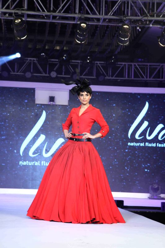 Actor Kangana Ranaut walks the ramp during the launch of Birla Cellulose LIVA, a new age fabric in Mumbai on March 27, 2015.