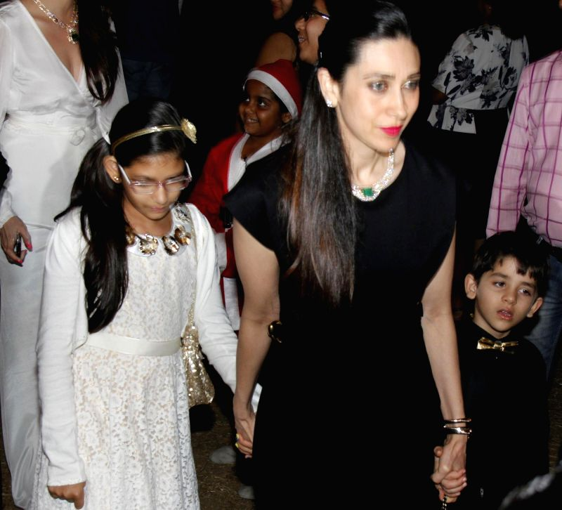 Actor Karishma Kapoor with her son Kiaan Raj Kapoor and daughter Samiera Kapoor attend the Midnight Mass on Christmas Eve at a Church in Mumbai, on Dec 24, 2014. - Karishma Kapoor, Kiaan Raj Kapoor and Samiera Kapoor