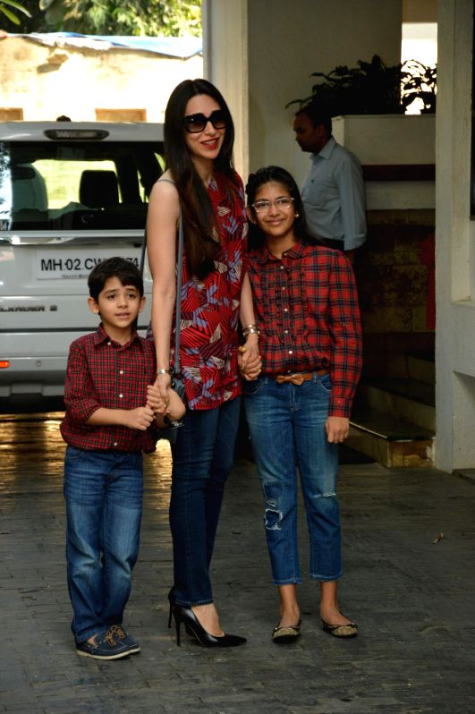 Actor Karishma Kapoor with her son Kiaan Raj Kapoor and daughter Samiera Kapoor at the annual Christmas lunch hosted by Sashi Kapoor in Mumbai, on December 25, 2014. - Karishma Kapoor, Kiaan Raj Kapoor, Samiera Kapoor and Sashi Kapoor