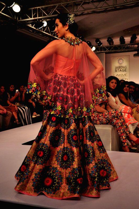 Actor Karisma Kapoor displays an outfit by designer Neha Agarwal at the Lakme Fashion Week Summer Resort 2015 in Mumbai, on March 21, 2015 - Karisma Kapoor