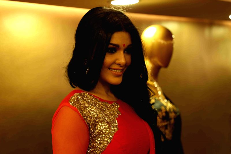 Actor Koena Mitra during the launch of KCouture fashion store in Mumbai on Feb 17, 2015. (Photo : IANS)