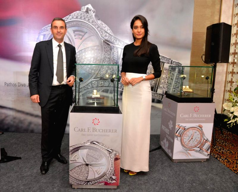 Actor Lisa Haydon and Mr. Jerome Riff, Managing Director Carl F. Bucherer, during the launch of Carl F. Bucherer`s new ladies collection Pathos held at the Palladium Hotel in Mumbai, on Nov ..