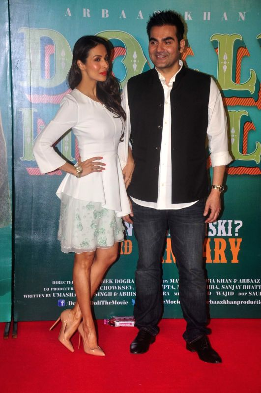 Actor Malaika Arora Khan and Filmmaker and actor Arbaaz Khan during the trailer launch of film Dolly Ki Doli in Mumbai, on Dec. 12, 2014. - Malaika Arora Khan and Arbaaz Khan