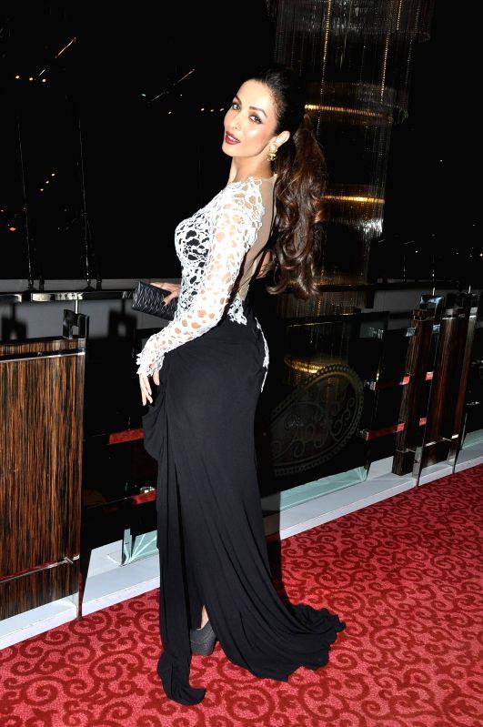 Actor Malaika Arora Khan during the grand finale of Kama Sutra Miss Maxim 2015, in Mumbai, on Dec 21, 2014. - Malaika Arora Khan
