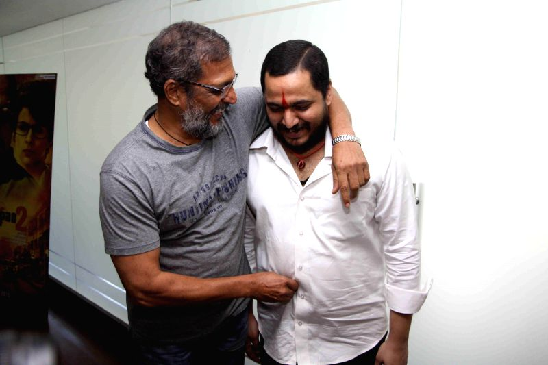 Actor Nana Patekar along with his son Malhar Patekar during the promotion of film Ab Tak Chhappan 2 in Mumbai on Feb 17, 2015. ( Photo : IANS ) - Nana Patekar