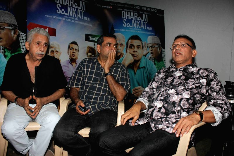 Actor Nasseruddin Shah, Paresh Rawal and Annu Kapoor during media interaction of up coming film Dharam Sankat Mein in Mumbai on March 28, 2015. - Nasseruddin Shah and Annu Kapoor
