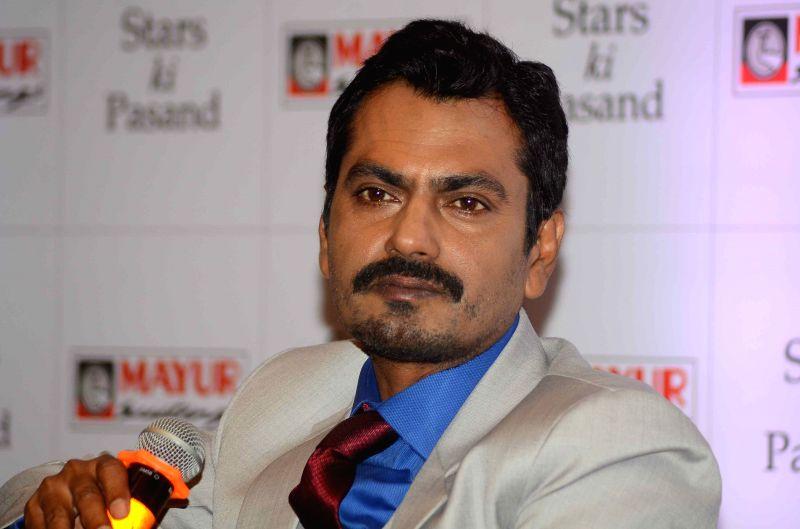 :Mumbai: Actor Nawazuddin Siddiqui at the press conference announcing him as the new brand ambassador of Mayur Suitings in Mumbai on Oct. 6, 2015. (Photo: IANS). - Nawazuddin Siddiqui