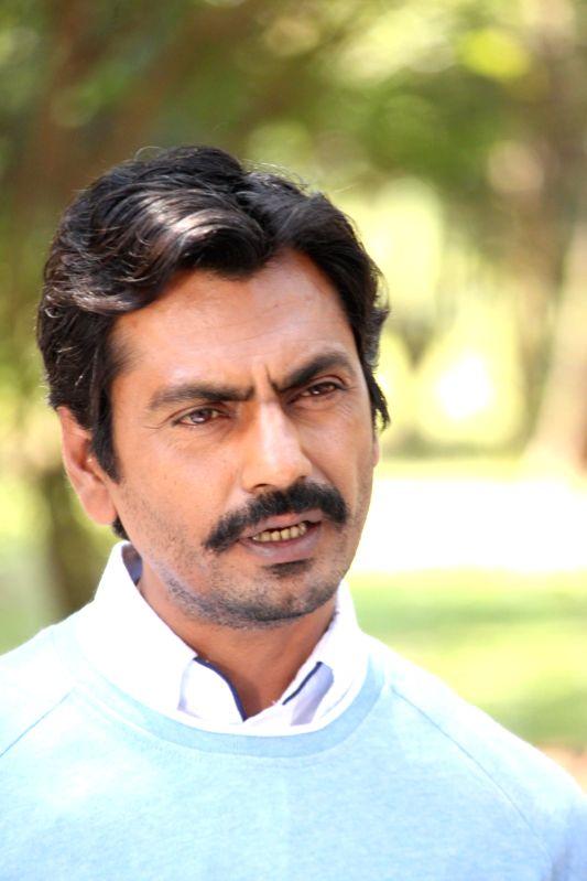 Actor Nawazuddin Siddiqui on the sets of Savdhaan India in mumbai on Feb. 8, 2015. (Phato: IANS)