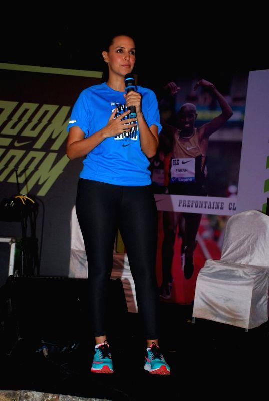Actor Neha Dhupia during the promotion for NIKE ZOOM BOOM (marathon run) in Mumbai, on Dec. 20, 2014.