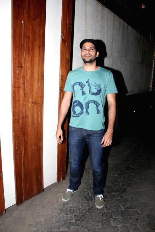 Actor Neil Bhoopalam leaves after attending a get-together at actor Farhan Akhtar`s home, in Mumbai on April 10, 2015. - Neil Bhoopalam