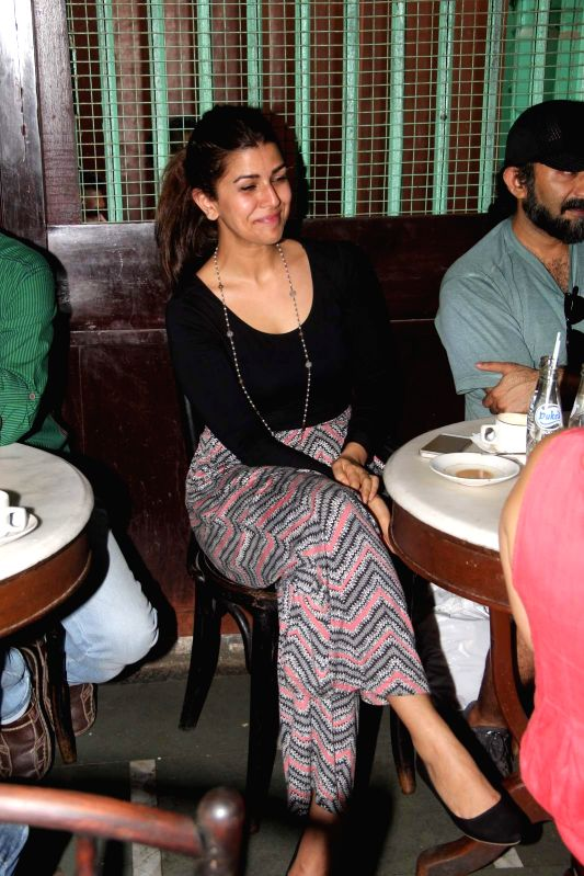 Actor Nimrat Kaur during the launch of Ritesh Batra`s `Poetic License` at Irani Cafe, in Mumbai on April 4, 2015. - Nimrat Kaur