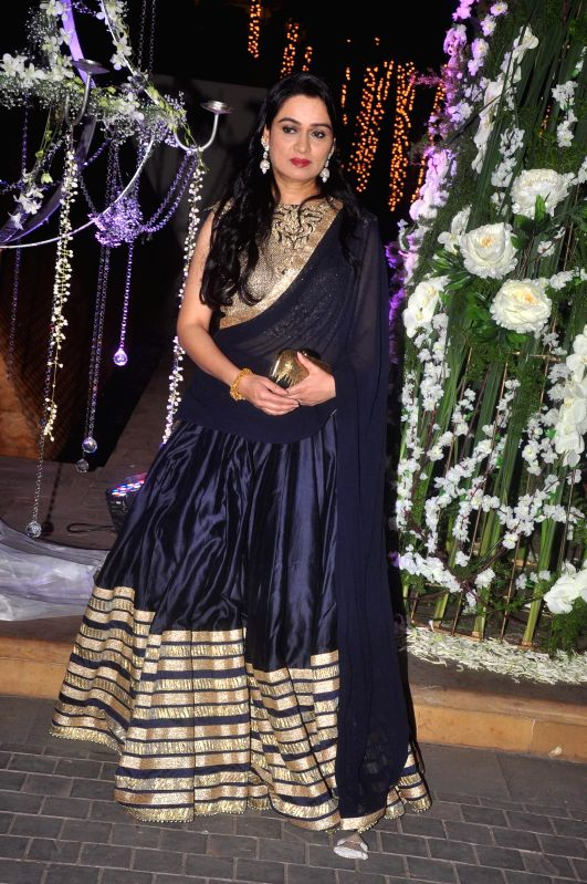 Actor Padmini Kolhapure during Riddhi Malhotra and Tejas Talwalkar's sangeet ceremony in Mumbai, on December 13, 2014. - Padmini Kolhapure