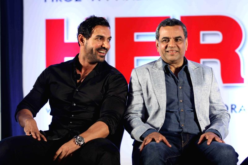 Actor Paresh Rawal and John Abraham during during unveiling of the starcast of film Hera Pheri 3, in Mumbai, on Jan. 12, 2015. - Paresh Rawal and John Abraham
