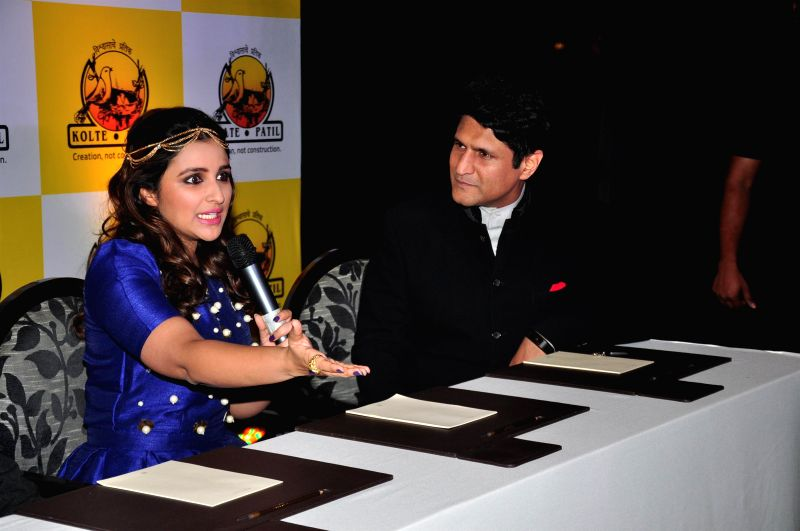 Actor Parineeti Chopra and host Rajiv Makhni during the launch of KPDL Mobile App - Customer Connect and Partner Connect in Mumbai, on Jan. 16, 2015. - Parineeti Chopra