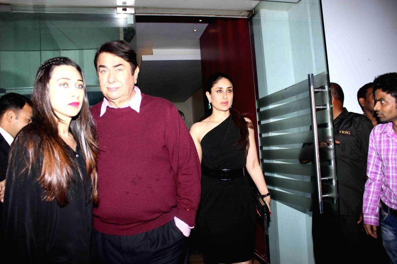 Actor Randhir Kapoor with his daughters Karishma Kapoor and Kareena Kapoor during the birthday party of actor Randhir Kapoor in Mumbai on Feb 15, 2015. - Karishma Kapoor and Kareena Kapoor