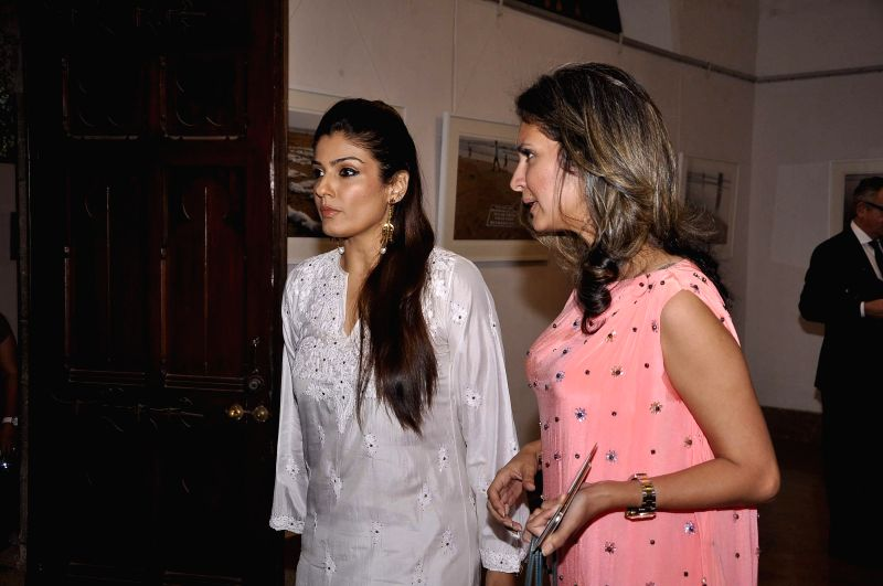Actor Raveena Tondon and Ronitaa Italia Dhanu, Editor, GoodHomes India, during the announcement of the third edition of GoodHomes for Art in Mumbai, on Nov 27, 2014. - Raveena Tondon