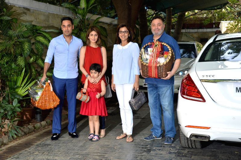 Actor Rishi Kapoor along with his wife Neetu Singh and daughter Riddhima Kapoor Sahni and Businessman Bharat Sahni at the annual Christmas lunch hosted by Sashi Kapoor in Mumbai, on December . - Rishi Kapoor, Neetu Singh, Riddhima Kapoor Sahni and Sashi Kapoor