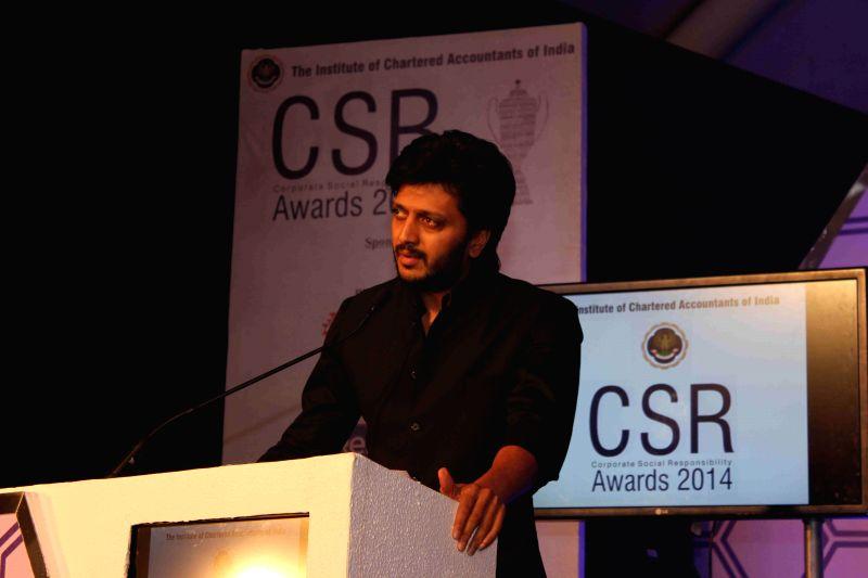 Actor Riteish Deshmukh during the ICAI CSR Awards 2014 in Mumbai, on Feb 5, 2015. - Riteish Deshmukh