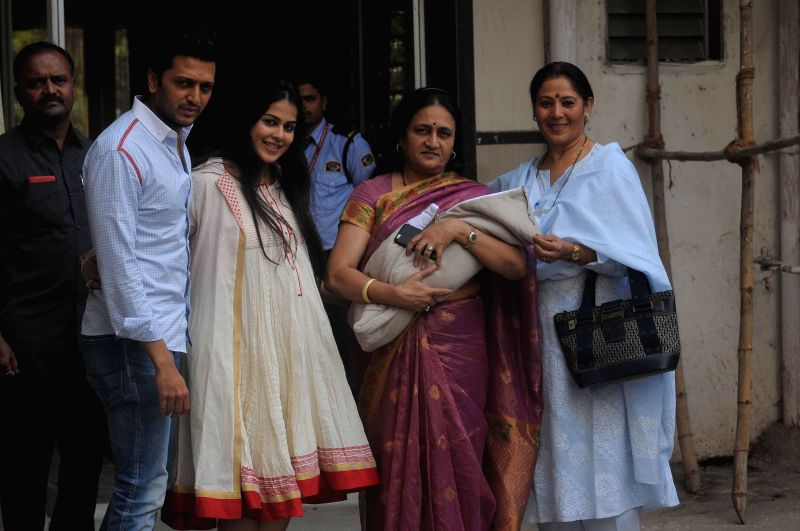 Actor Ritesh Deshmukh with wife Genelia and their new born baby boy, his mother and mother in law at their home in Poorna Building, Worli, Mumbai on Saturday, November 29, 2014.