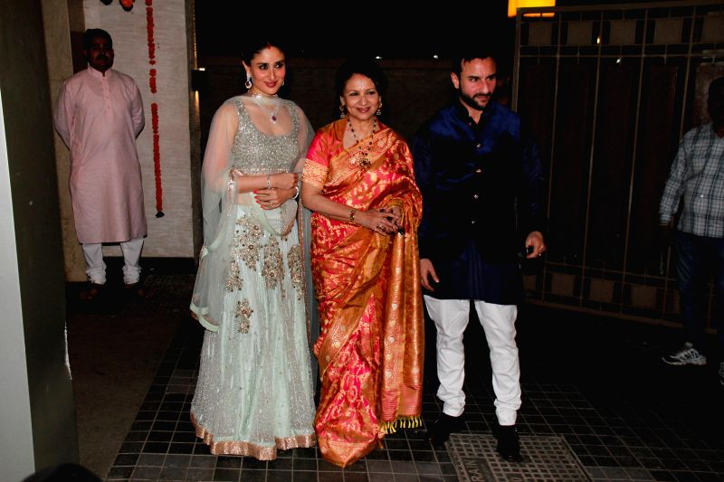 Actor Saif Ali Khan along with his wife Kareena Kapoor Khan and mother Sharmila Tagore during the wedding party of Soha Ali Khan and Kunal Kemu in Mumbai on Jan 25, 2015. - Saif Ali Khan and Kareena Kapoor Khan