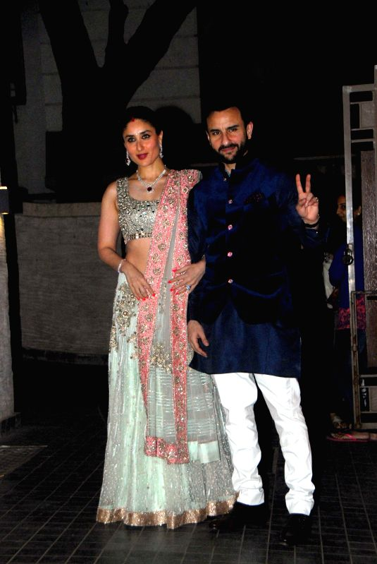 Actor Saif Ali Khan along with his wife Kareena Kapoor Khan during the wedding party of Soha Ali Khan and Kunal Kemu in Mumbai on Jan 25, 2015. - Saif Ali Khan and Kareena Kapoor Khan